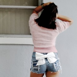 Shredded butt denim shorts with Vegan leather BOW. Custom. All sizes.