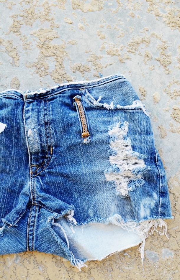 Dark denim shredded shorts. Size 4/5.