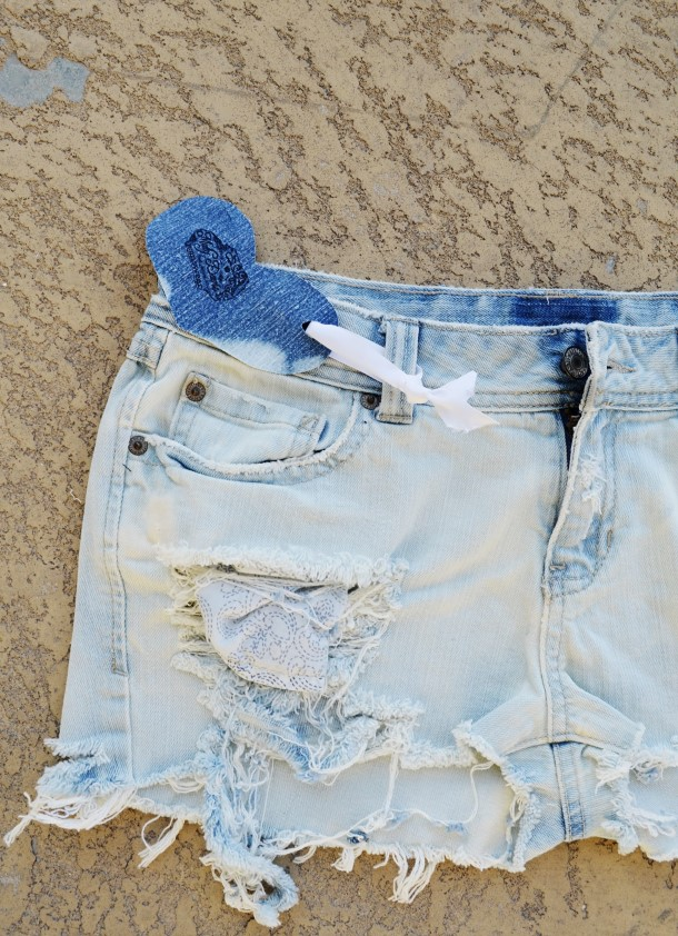 Bleached out denim shorts. Size 7/8