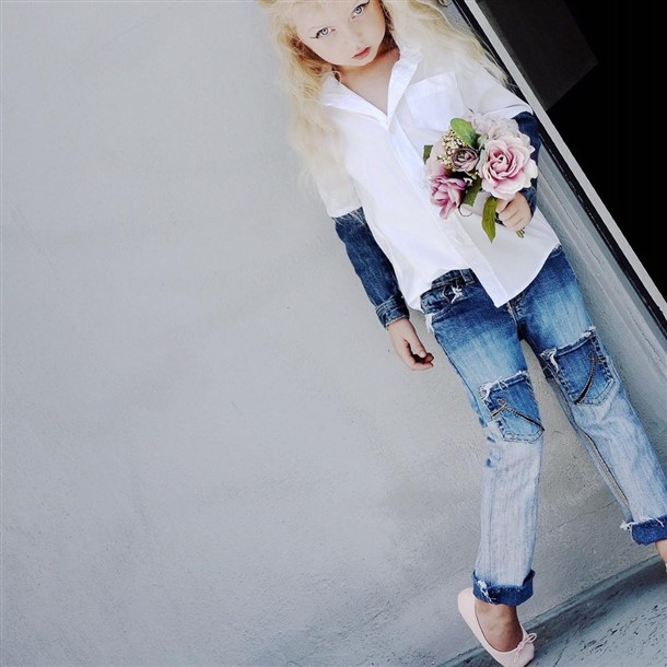 Girls White shirt with denim sleeves.