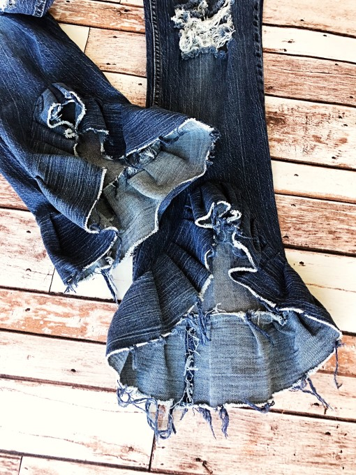 Destroyed high/low ruffle jeans. Ready to ship.