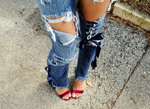 Destroyed denim ribbon jeans. Ready to ship.