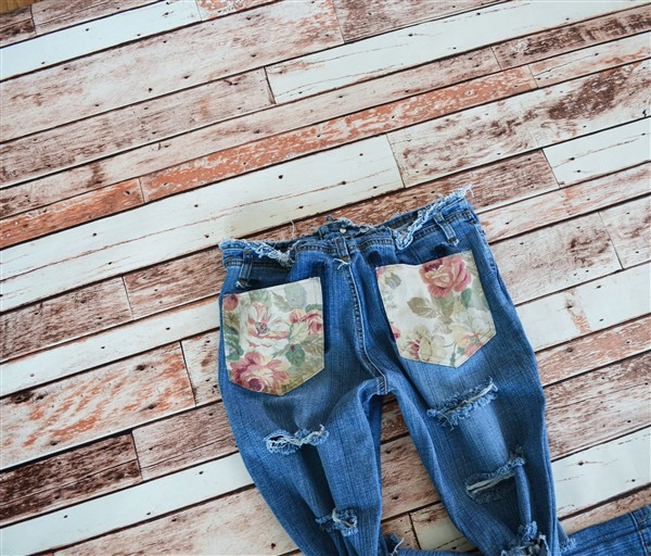 Double destroyed jeans with rose print pockets. SIZE 6.