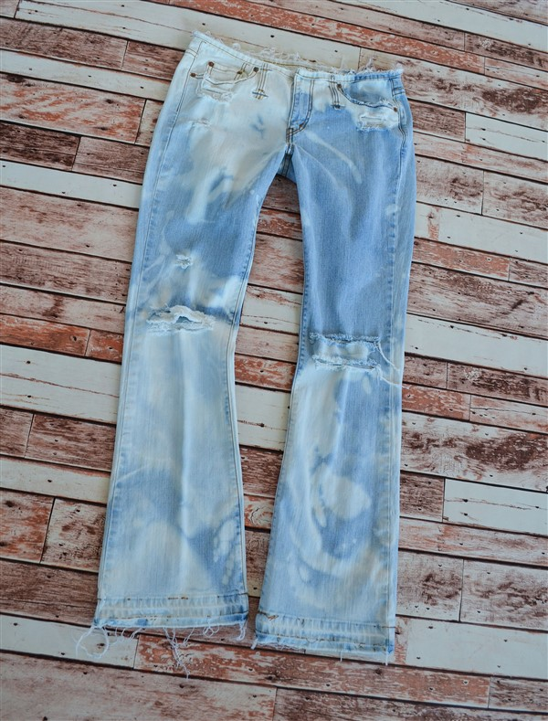 Bleached out flared jeans. Size 6/7.
