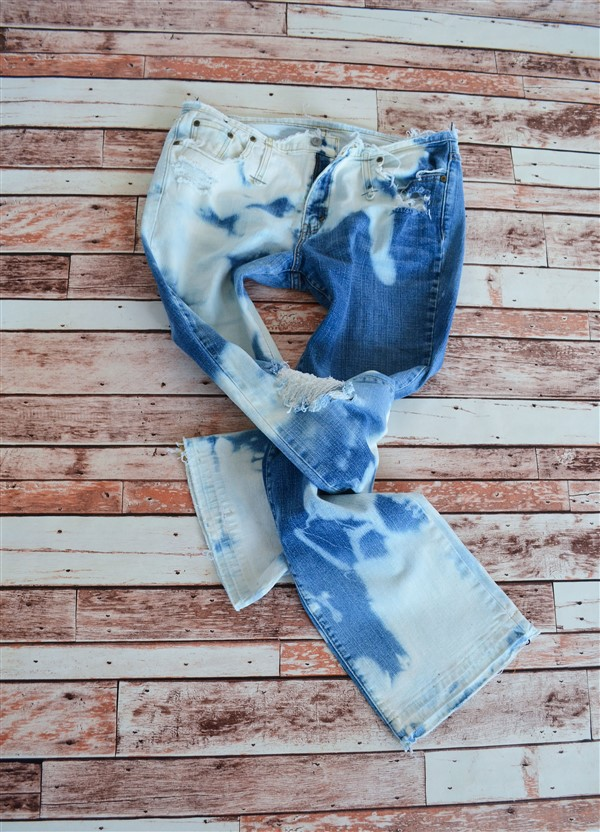 Bleached and destroyed flared jeans. Size 14.